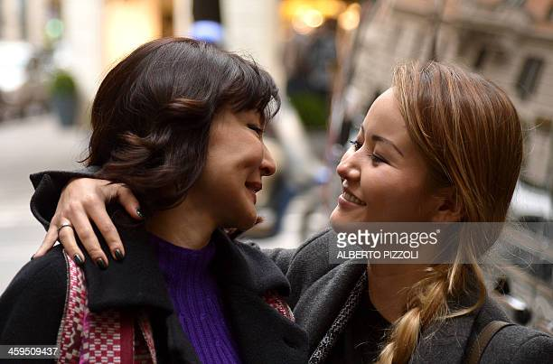 Alma Shalabayeva is welcomed by her daughter Madina as she arrives for a press conference after she arrived in Rome on December 27, 2013....