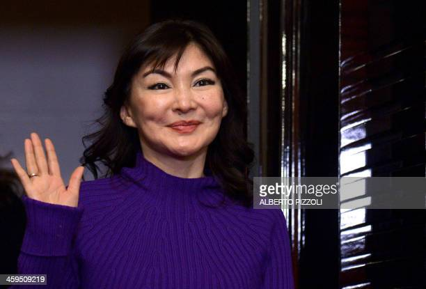 Alma Shalabayeva waves before giving a press conference after she arrived in Rome with her daughter on December 27, 2013. Shalabayeva, the wife of a...