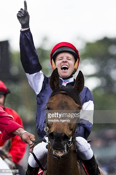 Almandin jockey Kerrin McEvoy celebrates after winning during 2016 Melbourne Cup at Flemington Racecourse Melbourne Australia November 1 2016 The...