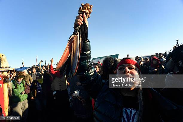Almarosa Silva Banuelos, an Aztec, celebrates at Oceti Sakowin camp on the Standing Rock Sioux Reservation on December 4, 2016 in Cannon Ball North...