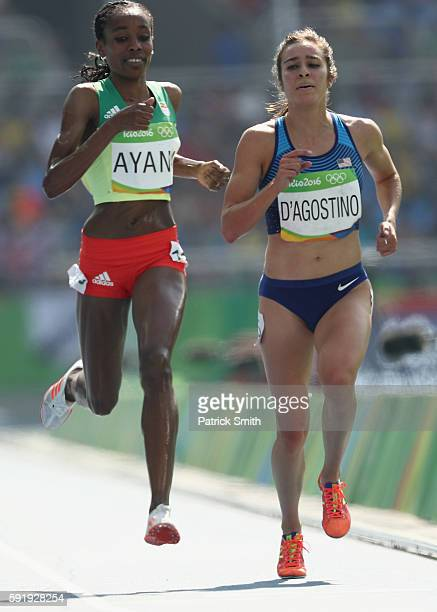Almaz Ayana of Ethiopia and Abbey D'Agostino of the United States compete during the Women's 5000m Round 1 on Day 11 of the Rio 2016 Olympic Games at...