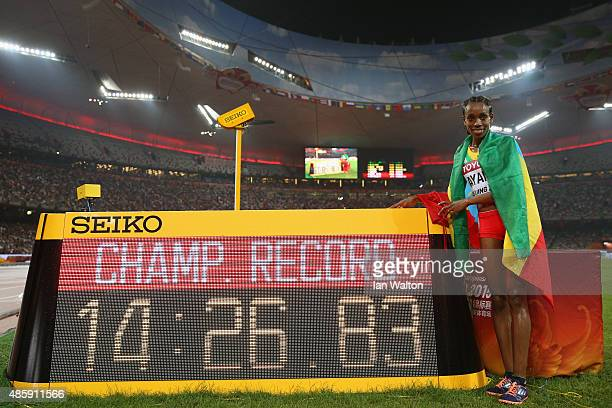 Almaz Ayana of Ethiopia celebrates after winning gold in the Women's 5000 metres final and setting a new Championship Record during day nine of the...