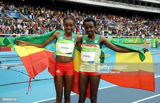 Almaz Ayana of Ethiopia celebrates winning the Women's 10000 Meters Final and setting a new world record of 291745 with third place finisher Tirunesh...