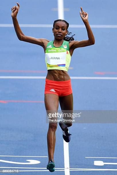 Almaz Ayana of Ethiopia celebrates winning the Women's 10000 Meters Final and setting a new world record of 291745 on Day 7 of the Rio 2016 Olympic...