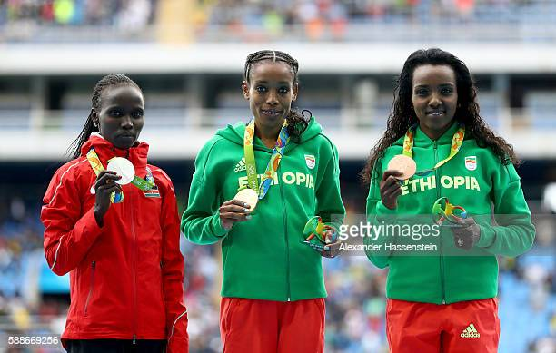 Almaz Ayana of Ethiopia gold medal Vivian Jepkemoi Cheruiyot of Kenya silver medal and Tirunesh Dibaba of Ethiopia bronze medal pose on the podium...