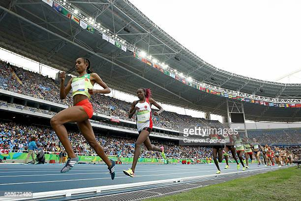 Almaz Ayana of Ethiopia leads a group in the Women's 10000 Meters Final on Day 7 of the Rio 2016 Olympic Games at the Olympic Stadium on August 12...