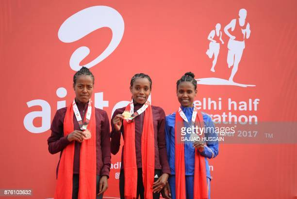 Almaz Ayana of Ethiopia poses with her gold medal with Ababel Yeshaneh of Ethiopia with silver medal and Netsanet Gudeta of Ethiopia with her bronze...