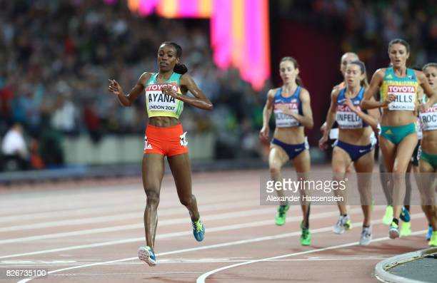 Almaz Ayana of Ethiopia raises her arms aloft as she crosses the line to win the Women's 10000 metres final during day two of the 16th IAAF World...