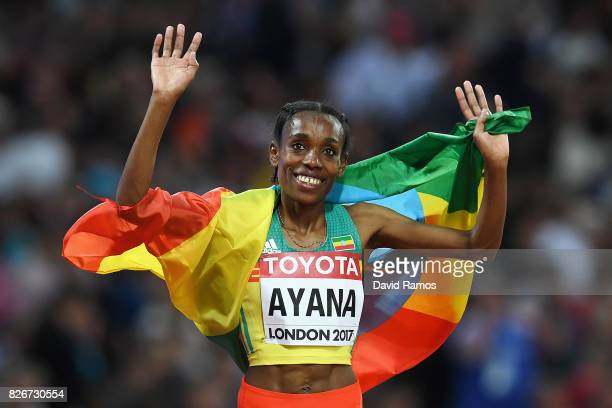 Almaz Ayana of Ethiopia waves her national flag on her lap of honour following her win in the Women's 10000 metres final during day two of the 16th...