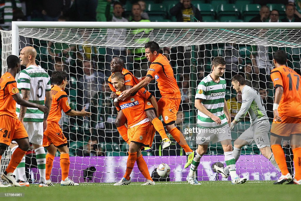Almen Abdi of Udinese is surrounded by team mates scoring the equalizer during the Europa League Group I match between Celtic and Udinese at Celtic Park on September 29, 2011 in Glasgow, United Kingdom.