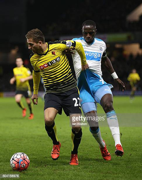 Almen Abdi of Watford and Moussa Sissoko of Newcastle United compete for the ball during the Emirates FA Cup Third Round match between Watford and...