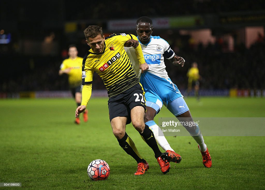 Almen Abdi of Watford and Moussa Sissoko of Newcastle United compete for the ball during the Emirates FA Cup Third Round match between Watford and Newcastle United at Vicarage Road on January 9, 2016 in Watford, England.