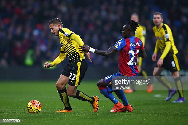 Almen Abdi of Watford and Pape N'Diaye Souare of Crystal Palace compete for the ball during the Barclays Premier League match between Crystal Palace...