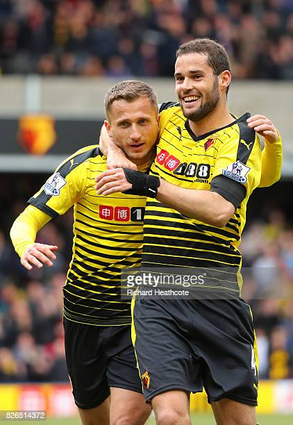 Almen Abdi of Watford celebrates scoring his team's first goal with his team mate Mario Suarez during the Barclays Premier League match between...