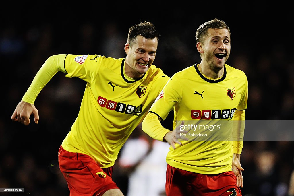 Almen Abdi (right) of Watford celebrates with team mates after scoring his sides fourth goal during the Sky Bet Championship match between Fulham and Watford at Craven Cottage on December 5, 2014 in London, England.