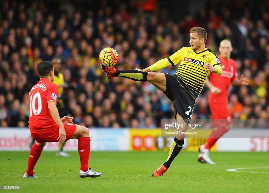 Almen Abdi of Watford controls the ball from Philippe Coutinho of Liverpool during the Barclays Premier League match between Watford and Liverpool at Vicarage Road on December 20, 2015 in Watford, England.