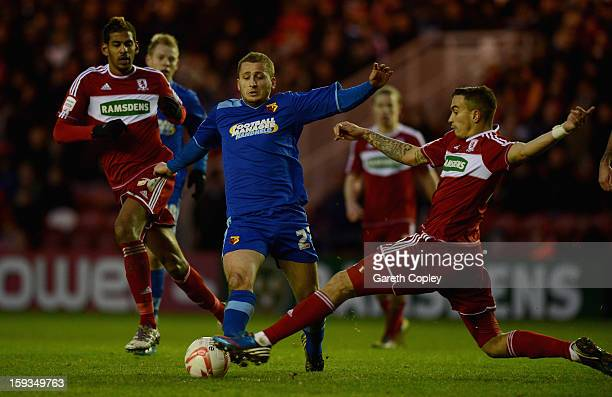 Almen Abdi of Watford gets past Faris Haroun and Seb Hines of Middlesborough during the npower Championship match between Middlesbrough and Watford...