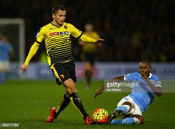 Almen Abdi of Watford is tackled by Fernandinho of Manchester City during the Barclays Premier League match between Watford and Manchester City at...
