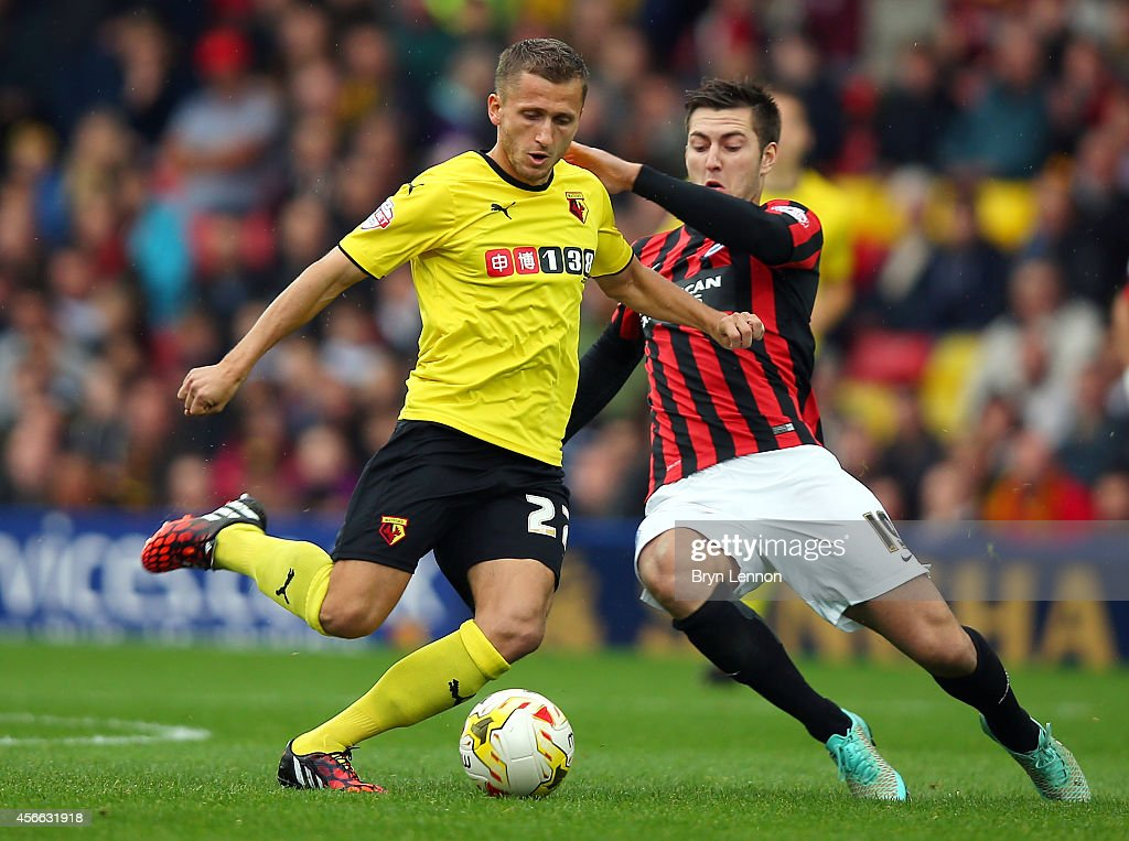 Almen Abdi of Watford is tackled by Gary Gardner of Brighton & Hove Albion during the Sky Bet Championship match between Watford and Brighton & Hove Albion at Vicarage Road on October 4, 2014 in Watford, England.