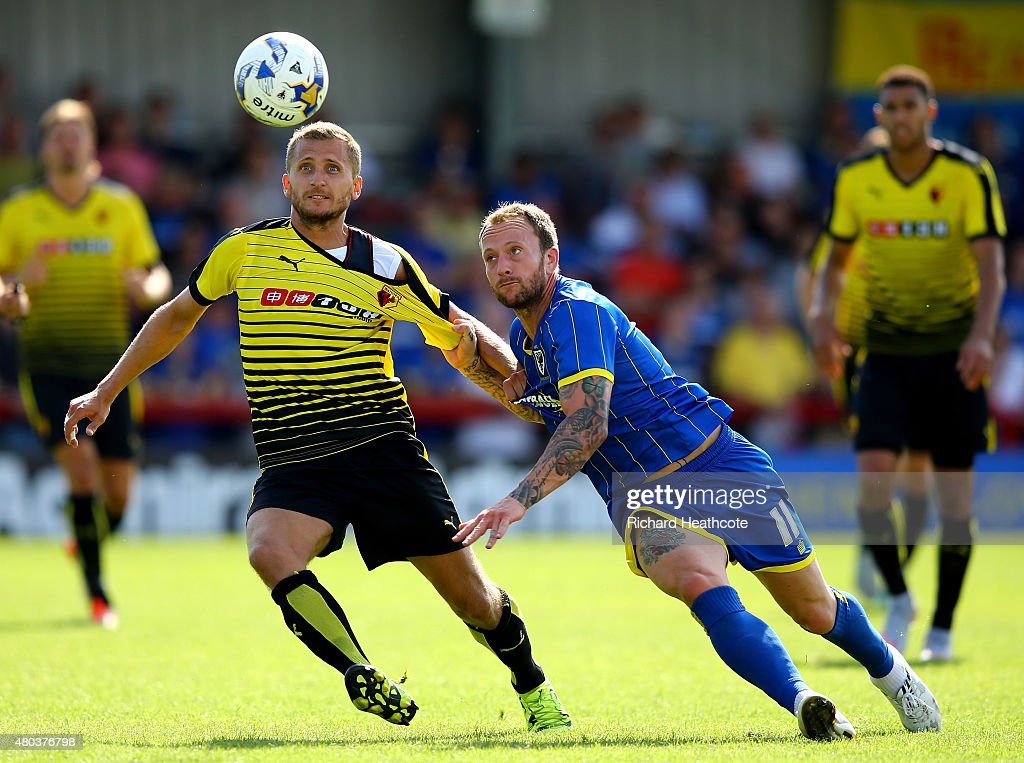 Almen Abdi of Watford tussels with Sean Rigg during the Pre Season Friendly match between AFC Wimbledon and Watford at The Cherry Red Records Stadium on July 11, 2015 in Kingston upon Thames, England.