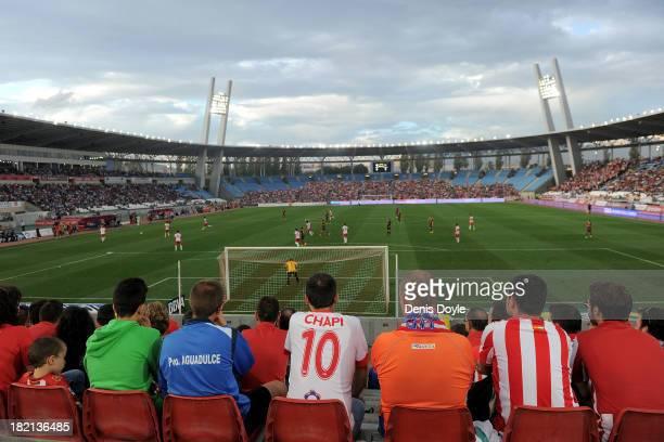 Almeria fans watch their team play FC Barcelona during the La Liga match between UD Almeria and FC Barcelona at Estadio de los Juegos Mediterraneos...