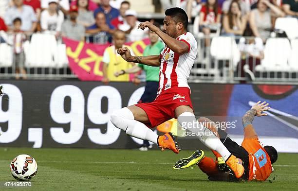 Almeria's defender Mauro Javier dos Santos vies with Valencia's forward Paco Alcacer during the Spanish league football match UD Almeria vs Valencia...