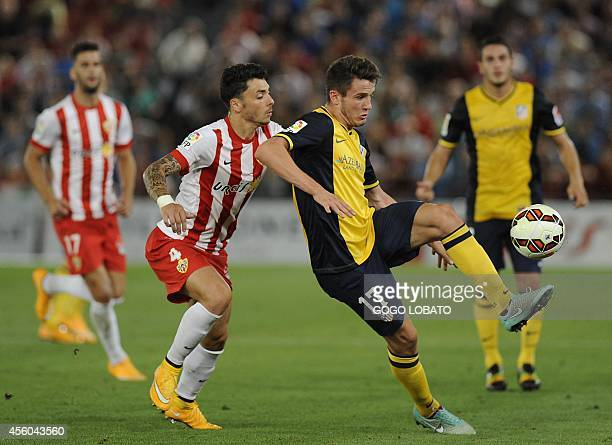 Almeria's forward Ximo Navarro vies with Atletico Madrid's Mexican forward Raul Jimenez during the Spanish league football match UD Almeria vs Club...