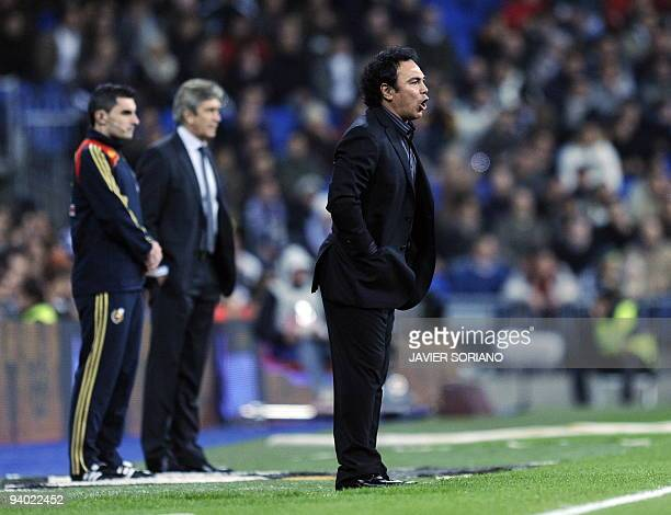 Almeria's Mexican coach Hugo Sanchez gives instructions to his players during a Spanish league football match at Santiago Bernabeu stadium on...