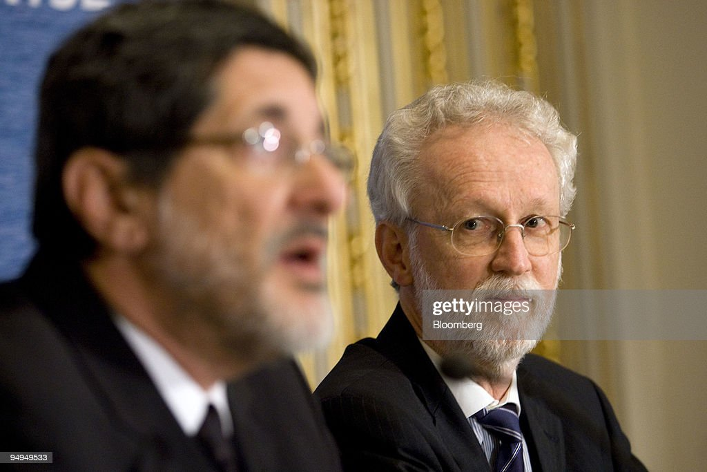 Almir Guilherme Barbassa, chief financial officer of Petroleo Brasileiro SA (Petrobras), right, listens to Jose Sergio Gabrielli, chief executive officer of Petrobras, speak during a news conference at the New York Stock Exchange in New York, U.S., on Thursday, May 21, 2009. China Petroleum, also known as Sinopec, will get 150,000 barrels of oil a day this year from Petrobras under one of 13 accords signed this week in Beijing and 200,000 barrels a day between 2010 and 2019.
