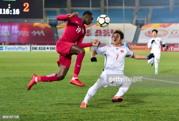 Almoez Ali of Qatar and Nguyen Phong Hong Duy of Vietnam compete for the ball during the AFC U23 Championship semifinal match between Qatar and...