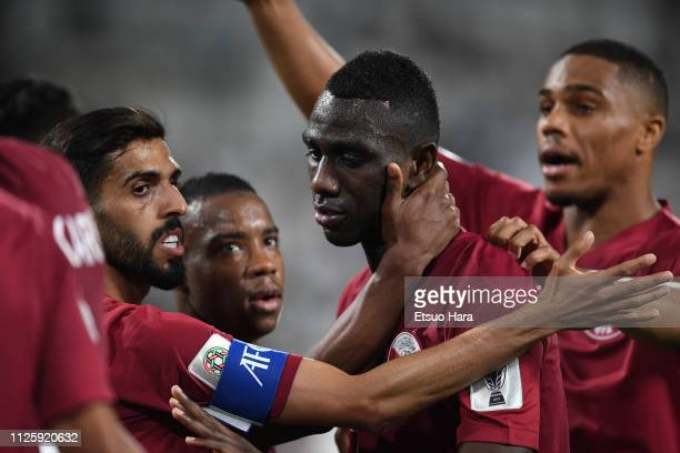 Almoez Ali of Qatar celebrates scoring his side's second goal during the AFC Asian Cup semi final match between Qatar and United Arab Emirates at...
