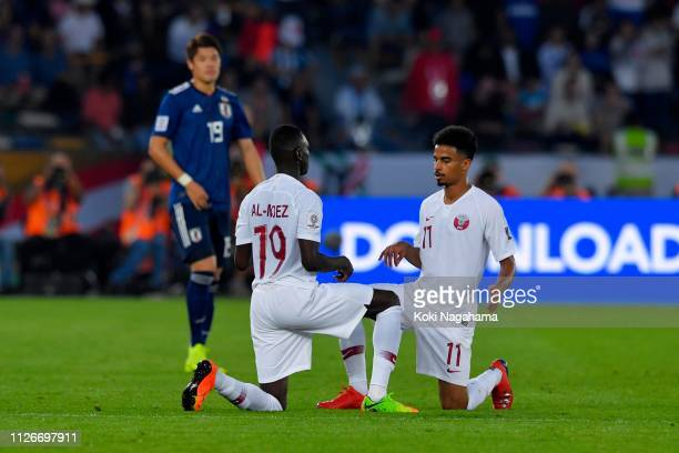 Almoez Ali of Qatar celebrates scoring the opening goal with his team mate Akram Hassan Afif during the AFC Asian Cup final match between Japan and...