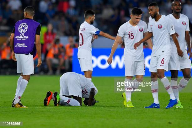 Almoez Ali of Qatar celebrates scoring the opening goal with his team mates during the AFC Asian Cup final match between Japan and Qatar at Zayed...