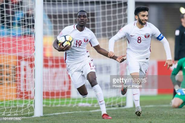 Almoez Ali of Qatar celebrating his goal with his teammate Ahmad Moein of Qatar during the AFC U23 Championship China 2018 Group A match between...