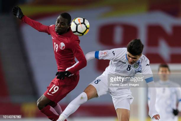 Almoez Ali of Qatar fights for the ball with Jasurbek Yakhshiboev of Uzbekistan during the AFC U23 Championship China 2018 Group A match between...