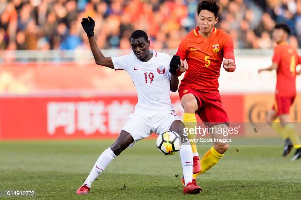 Almoez Ali of Qatar in action against Gao Zhunyi of China during the AFC U23 Championship China 2018 Group A match between China and Qatar at...
