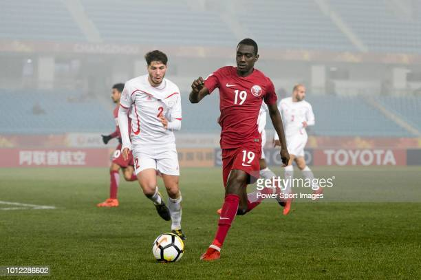 Almoez Ali of Qatar plays against Michel Termanini of Palestine during the AFC U23 Championship China 2018 Quarter Finals match between Qatar and...