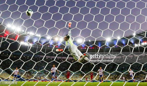 Almoez Ali of Qatar scores the first goal of his team over Roberto Fernández goalkeeper of Paraguay during the match against Paraguay for the Copa...