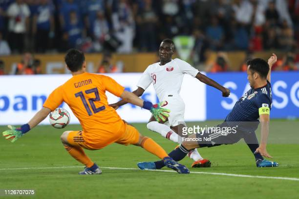 Almoez Ali of Qatar takes a shot at goal but is saves by Shuichi Gonda of Japan during the AFC Asian Cup final match between Japan and Qatar at Zayed...