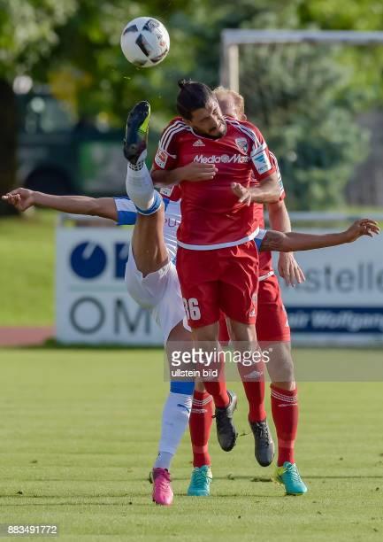 Almog Cohen im Zweikampf mit Ex Ingolstaedter Elias Kachunga waehrend dem Fussball Testspiel FC Ingolstadt 04 gegen Huddersfield Town FC fuer die...