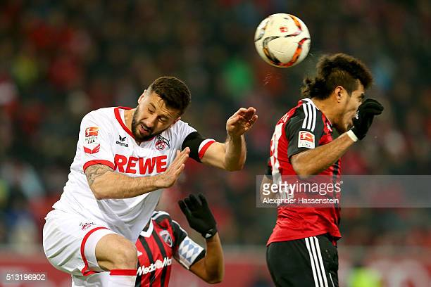 Almog Cohen of Ingolstadt battles for the ball with Dominic Maroh of Koeln during the Bundesliga match between FC Ingolstadt and 1 FC Koeln at Audi...