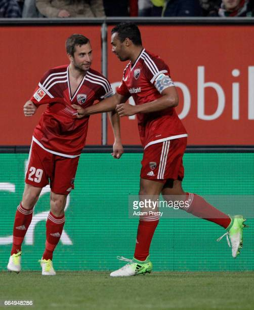Almog Cohen of Ingolstadt celebrate with team mate Markus Suttner after he scores the third goal during the Bundesliga match between FC Augsburg and...