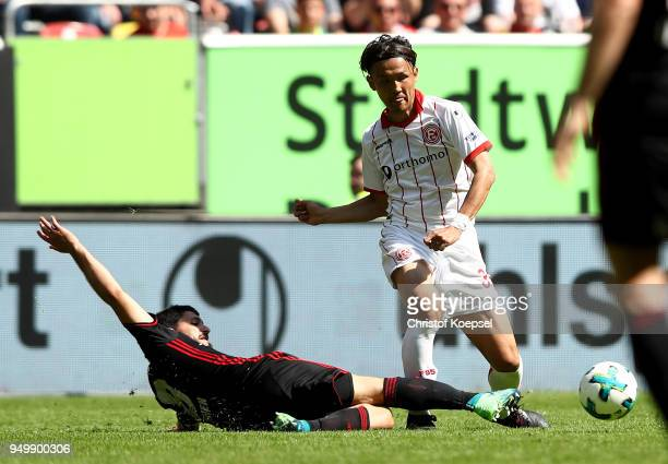 Almog Cohen of Ingolstadt challenges Takashi Usami of Duesseldorf during the Second Bundesliga match between Fortuna Duesseldorf and FC Ingolstadt 04...