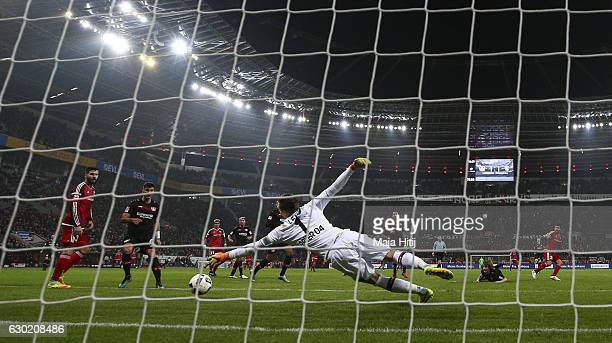 Almog Cohen of Ingolstadt scores his team's second goal against goalkeeper Bernd Leno of Leverkusen to make it 12 during the Bundesliga match between...