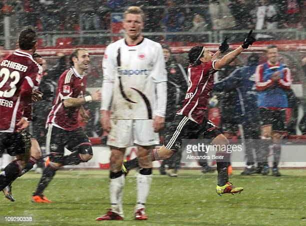 Almog Cohen of Nuernberg celebrates his first goal with his teammates Javier Pinola and Julian Schieber during the German Bundesliga match between 1...