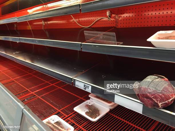 Almolst empty freezer that contained meats at a grocery store as panic buying and hoarding of food and sanitary items continues due to fear of the...