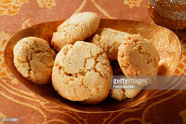 Almond biscuits in brown bowl