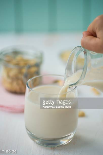 Almond milk being poured into a glass