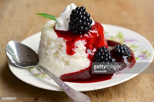 Almond rice pudding with blackberry sauce