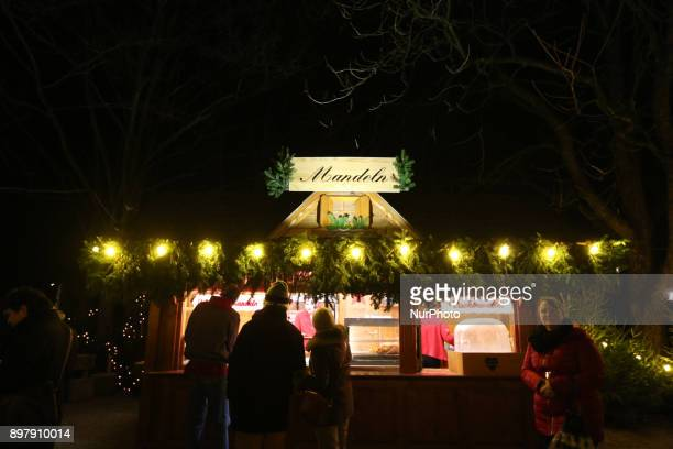 Almond stand Last Day of the Christmas Market at quotChinesischer Turmquot in Munich on December 23 2017